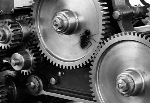 Virus qui se promène entre les rouage d'une machine industrielle